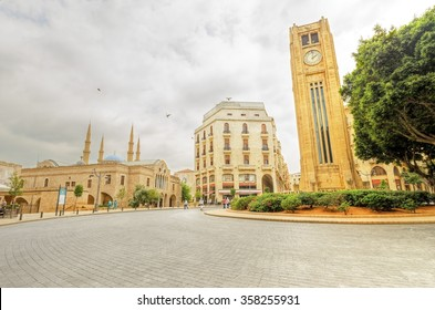 BEIRUT, LEBANON - 12 AUGUST, 2013: The clock tower in Nejme Square in Beirut, Lebanon, some local architecture of downtown Beirut, the Mohammad Al-Amin mosque and Greek orthodox church of St George.