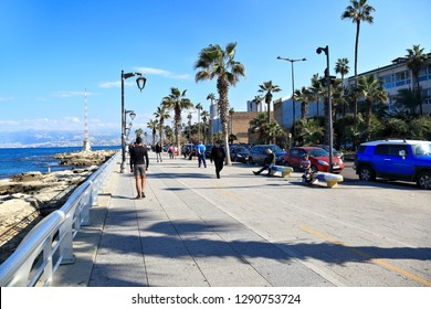 Beirut, Lebanon - 12/24/2018- people strolling on Corniche el Manara at the seafront