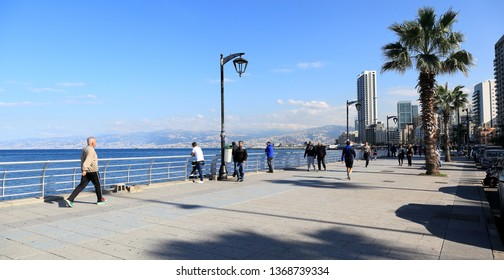Beirut, Lebanon - 12.25.2018: People relaxing and strolling on the seaside Corniche, one of the few outdoor spaces available for recreation in the city.