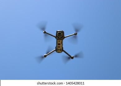 Beirut, Lebanon - 5/18/2019: DJI Mavic 2 pro hovering under blue sky with its camera facing down