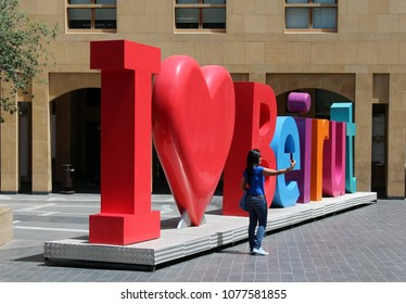 BEIRUT, LEBANON – April 2018: Tourist takes selfie photo in front of I love Beirut sign in Downtown Beirut