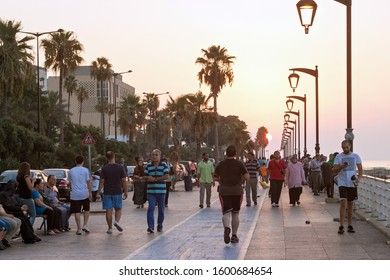 BEIRUT, LEBANON - AUGUST 14, 2014: View of the Corniche boulevard in the Raouche (is a residential and commercial neighborhood in Beirut). The corniche is popular on weekends and evenings.