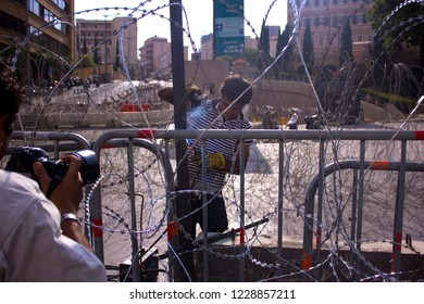 Beirut, Lebanon - August 25, 2015: Lebanese protests. People construct concrete and wire barricades went on a protest against trash crisis. Arabic spring protest in Beirut, Lebanon .