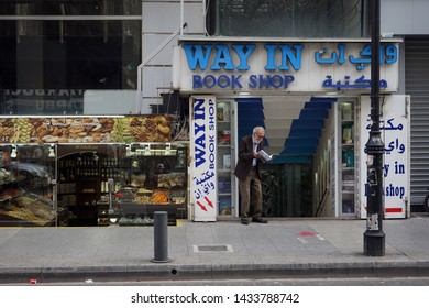 BEIRUT, LEBANON - CIRCA APRIL 2019 Man with magazine and book shop