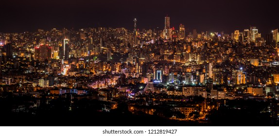 BEIRUT, LEBANON - DECEMBER 9, 2016: Night city background, beautiful urban cityscape, Beirut with street lights, high buildings and skyscrapers,panoramic dark town pattern.