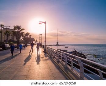 BEIRUT, LEBANON - MAY 22, 2017: People walking on the Corniche Promenade at sunset.