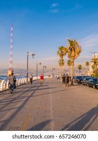 BEIRUT, LEBANON - MAY 22, 2017 - Unidentified people walking on the seaside at sunset.