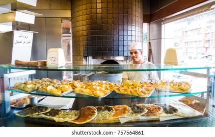 BEIRUT, LEBANON - NOVEMBER 1, 2017 - Traditional Lebanese sweets and pizza.