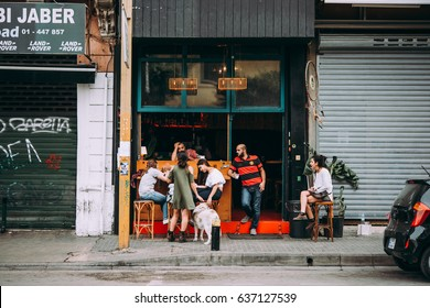 BEIRUT, LEBANON - NOVEMBER, 16, 2016: People relax and talk in front of one the bars in Gemmayze district in Beirut, Lebanon.