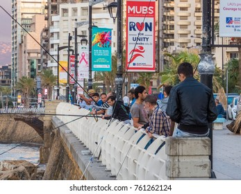 BEIRUT, LEBANON - NOVEMBER 2, 2017: Unidentified people fishing at sunset on La Corniche, a seaside promenade in Beirut Central District.