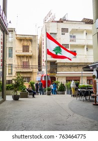 BEIRUT, LEBANON - NOVEMBER 5, 2017 - Lebanese flag in front of the Cable Car in Jounieh.