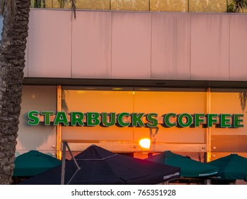 BEIRUT, LEBANON - NOVEMBER 7, 2017 - Starbucks Coffee shop window at sunset.