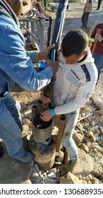 Beirut Lebanon on February 07, 2019: people was holding a submersible pump at borehole area