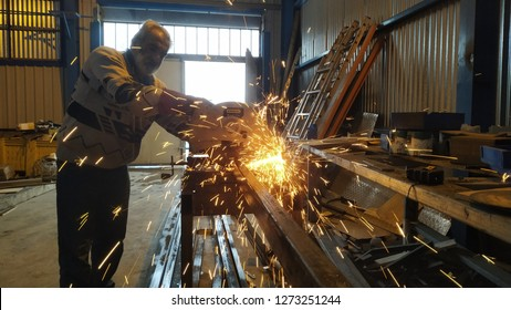 Beirut Lebanon on January 03, 2019: a man was cutting metal bar in the workshop