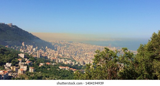 Beirut, Mount Lebanon/Lebanon-May 21th 2019:  Large overview of Beirut and Jounieh and the mediterranee shot from a Hill,  under a dramatic cloud of atmospheric pollution