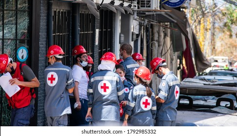 Beirut/Lebanon - 08/09/2020 - group of red cross rescue workers in a street in Beirut are discussing the rescue efforts after an explosion
