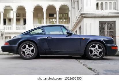 beirut,lebanon april 4th,2019:vintage blue porsche 911 carrera side view