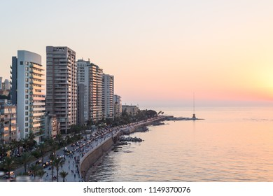 Beirut's corniche sea front with high rise residential buildings and pedestrian walkway along the Mediterranean sea, Lebanon