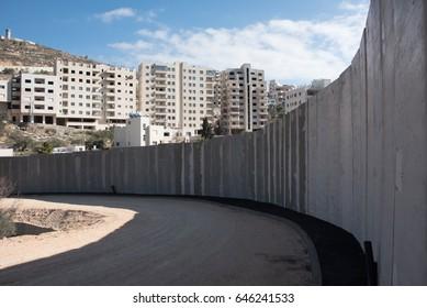 BEIT JALA, WEST BANK - DECEMBER 30: The Israeli Separation Wall divides land belonging to the West Bank village of Beit Jala, December 30, 2016.