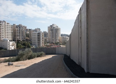 BEIT JALA, WEST BANK - DECEMBER 30: The Israeli Separation Wall divides olive groves belonging to the West Bank village of Beit Jala, December 30, 2016.