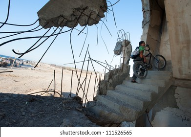 BEIT LAHIA, GAZA - JULY 4: Palestinian children stand among the ruins of buildings in Beit Lahia, Gaza, destroyed by Israeli air strikes in the 2008-2009 war known as Operation Cast Lead, July 4, 2012