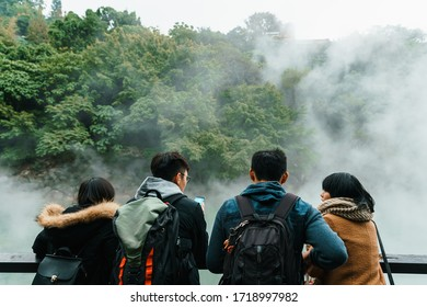 BEITOU, TAIWAN. DEC 31, 2017: Tourist travel in The famous Beitou Thermal Valley in Beitou Park, boiling steam from hot spring floating through the trees in Taipei City, Taiwan.
