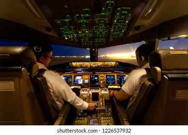 Bejing airport, China, September 6th, 2018: Two airline pilots are starting the airplane engines at night time. Pilots must monitor all concerned parameters while engine is in starting operation.