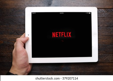 BEKASI, INDONESIA - FEBRUARY 20, 2016: Netflix app loading on iPad. Netflix is a global provider of streaming movies and TV series, and now has over 75 million subscribers.