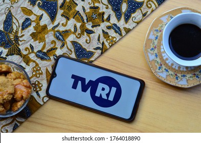 Bekasi, Indonesia - June 26,2020 : TVRI apps on smartphone, public television in Indonesia with breakfast concept