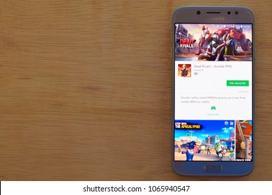 BEKASI, WEST JAVA, INDONESIA. APRIL 11, 2018 : Dead Rivals - Zombie MMO dev application on Samsung Smartphone screen. Dead Rivals - Zombie MMO is a freeware web browser developed by Gameloft