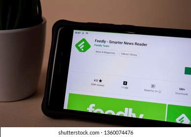 BEKASI, WEST JAVA, INDONESIA. APRIL 5, 2019 : Feedly - Smarter News Reader dev application on Smartphone screen. Feedly is a freeware web browser developed by Feedly Team