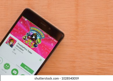 BEKASI, WEST JAVA, INDONESIA. FEBRUARY 20, 2018 : PewDiePie's Tuber Simulator Game application on Smartphone screen. PewDiePie's Tuber Simulator is a freeware web browser developed by Outerminds Inc