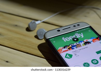 BEKASI, WEST JAVA, INDONESIA. JULY 09, 2018 : Feedly - Get Smarter application on Smartphone screen. Feedly - Get Smarter is a freeware web browser developed by Feedly Team
