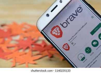 BEKASI, WEST JAVA, INDONESIA. JULY 23, 2018 : Brave Browser: Fast AdBlocker App on Smartphone screen. Brave Browser is a freeware web browser developed by Brave Software. Origami Autumn Background