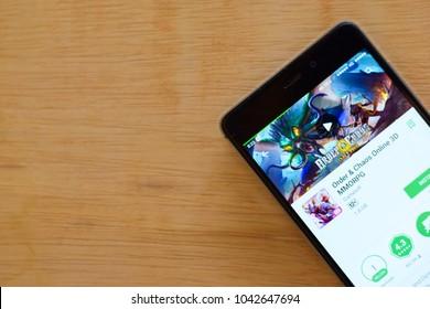 BEKASI, WEST JAVA, INDONESIA. MARCH 10, 2018 : Order 7 Chaos Online 3D MMORPG dev application on Smartphone screen. Order 7 Chaos Online 3D MMORPG is a freeware web browser developed by Gameloft