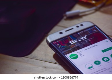 BEKASI, WEST JAVA, INDONESIA. MARCH 8, 2018 : Fiverr - Freelance Services dev application on Smartphone screen. Fiverr - Freelance Services is a freeware web browser developed by Fiverr