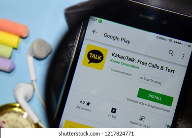 BEKASI, WEST JAVA, INDONESIA. NOVEMBER 1, 2018 : KakaoTalk: Free Calls & Text dev app with magnifying on Smartphone screen. KakaoTalk is a freeware web browser developed by Kakao Corporation