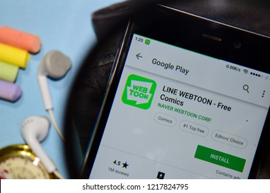 BEKASI, WEST JAVA, INDONESIA. NOVEMBER 1, 2018 : LINE WEBTOON - Free Comics dev app with magnifying on Smartphone screen. LINE WEBTOON is a freeware web browser developed by NAVER WEBTOON CORP