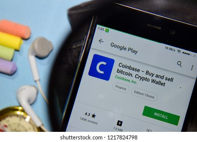 BEKASI, WEST JAVA, INDONESIA. NOVEMBER 1, 2018 : Coinbase - Buy and sell bitcoin. Crypto Wallet dev app with magnifying on Smartphone screen. is a freeware web browser developed by Coinbase, Inc