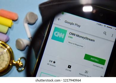 BEKASI, WEST JAVA, INDONESIA. NOVEMBER 1, 2018 : CNN MoneyStream dev app with magnifying on Smartphone screen. MoneyStream is a freeware web browser developed by CNN
