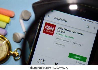 BEKASI, WEST JAVA, INDONESIA. NOVEMBER 1, 2018 : CNN Indonesia - Breaking News dev app with magnifying on Smartphone screen. Breaking News is a freeware web browser developed by PT. Trans Digital Medi