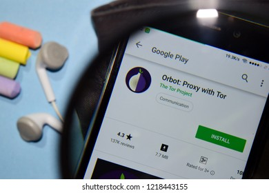 BEKASI, WEST JAVA, INDONESIA. NOVEMBER 1, 2018 : Orbot: Proxy with Tor dev app with magnifying on Smartphone screen. Orbot is a freeware web browser developed by The Tor Project
