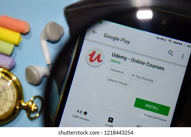 BEKASI, WEST JAVA, INDONESIA. NOVEMBER 1, 2018 : Udemy - Online Courses dev app with magnifying on Smartphone screen. Online Courses is a freeware web browser developed by Udemy