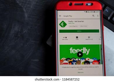 BEKASI, WEST JAVA, INDONESIA. SEPTEMBER 21, 2018 : Feedly - Get Smarter dev app on Smartphone screen. Feedly - Get Smarter is a freeware web browser developed by Feedly Team