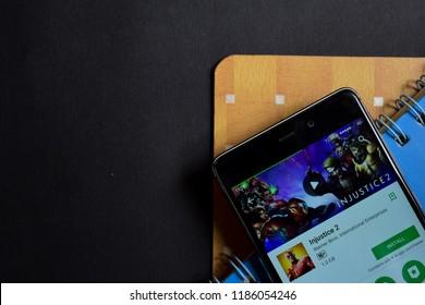 BEKASI, WEST JAVA, INDONESIA. SEPTEMBER 23, 2018 : Injustice 2 dev app on Smartphone screen. Injustice 2 is a freeware web browser developed by Warner Bros. International Enterprises