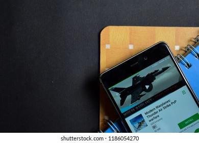BEKASI, WEST JAVA, INDONESIA. SEPTEMBER 23, 2018 : Modern Warplanes: Thunder Air Strike PvP warfare dev app on Smartphone screen. Modern Warplanes is a freeware web browser developed by GDCompany