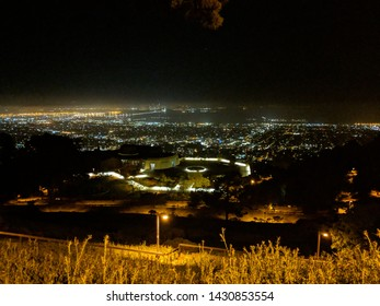 Bekerley, CA/USA - 04 13 2019: A night view of UC Berkeley campus, Oakland and San Francisco from the montain in UC Berkeley
