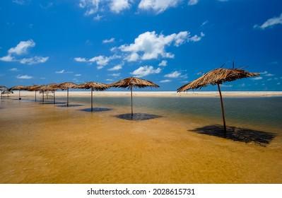 Bela beach, Conde, near João Pessoa, Paraíba, Northeast coast of Brazil. Straw umbrellas.