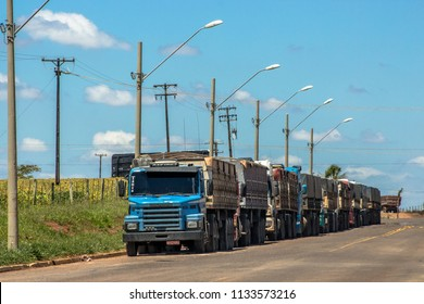 Bela Vista do Paraiso, Parana, Brazil, February 28, 2013. Row of trucks waiting to get into a crushing grain, on PR-445 road in Bela Vista do Paraiso city.