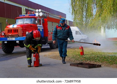 Belarus, Bobruisk District, Bolshie Bortniki Village, October 15, 2015: Demonstration performances for schoolchildren. Practical application of fire extinguishers and extinguishing the fire.
